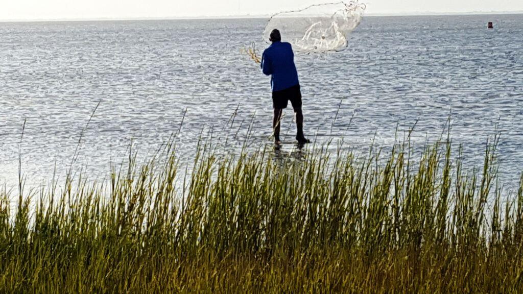 throwing a cast net