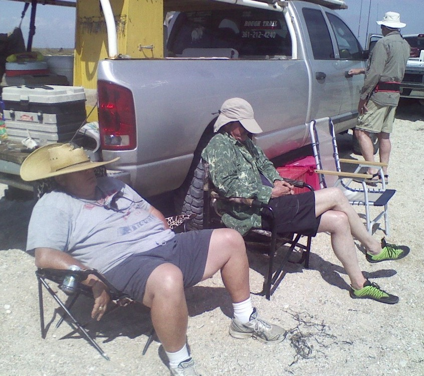 Pat Watkins and Jerry Gerwick napping on the beach