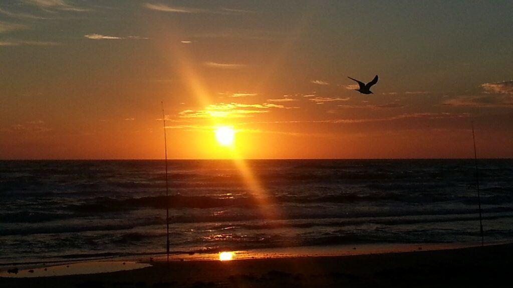 Sunrise over the surf at Follet's Island Texas