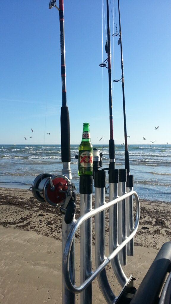 Surf rods in Anglers Fish n Mate 6 rod vehicle rod rack. Surf Fishing Quick Start Guide Review