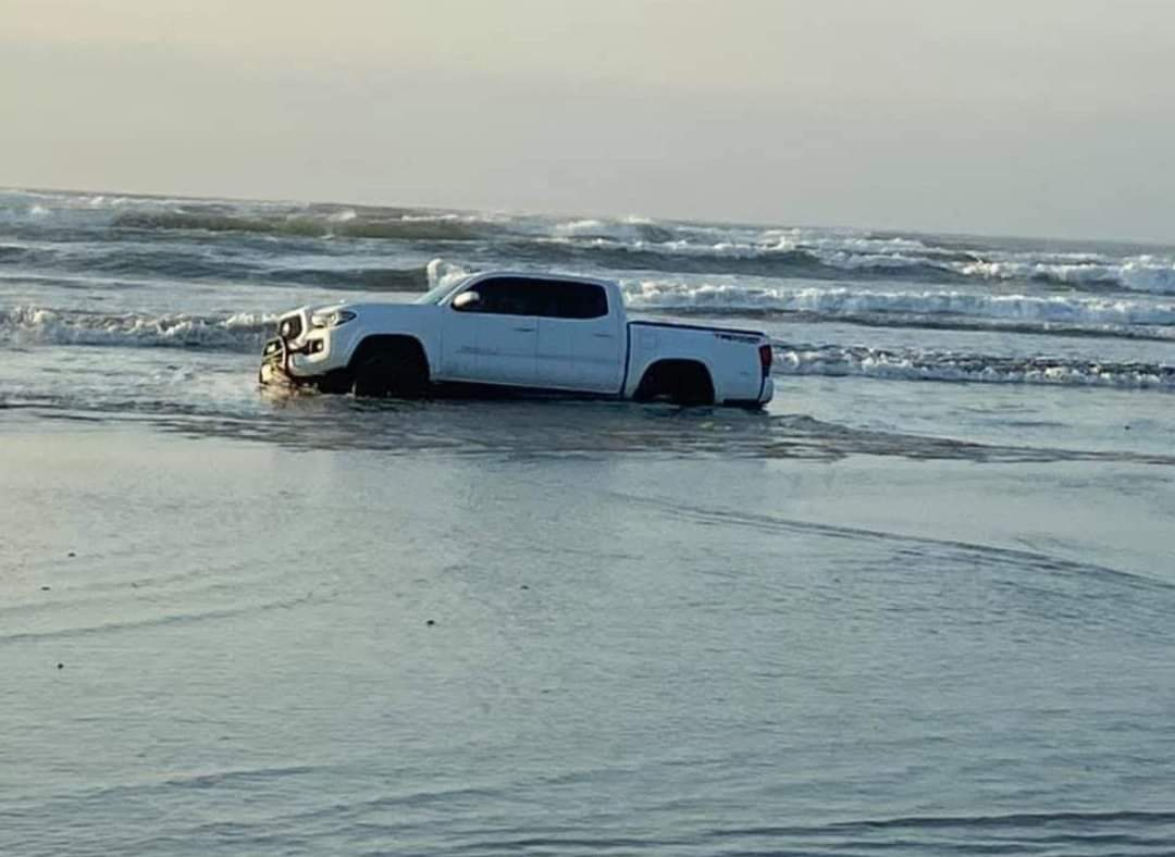buried on the beach