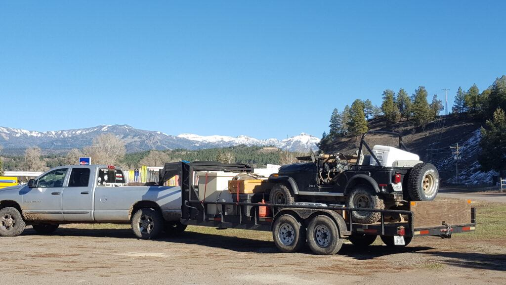 Loaded truck and trailer - outfitting a colorado elk hunt