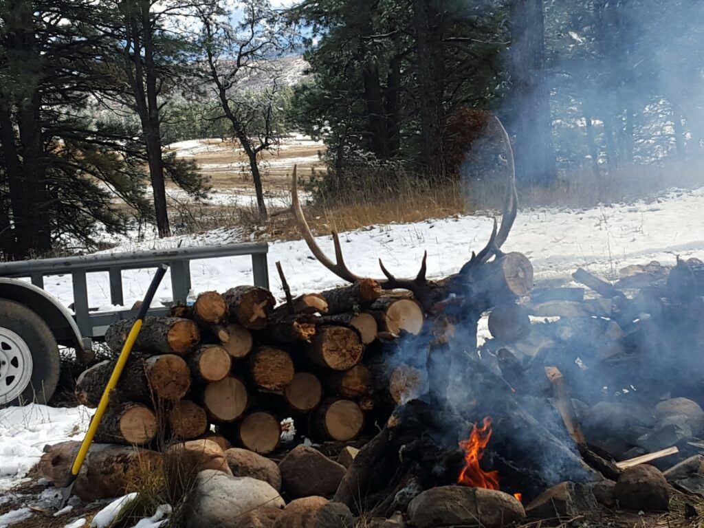elk antlers campfire - outfitting a colorado elk hunt