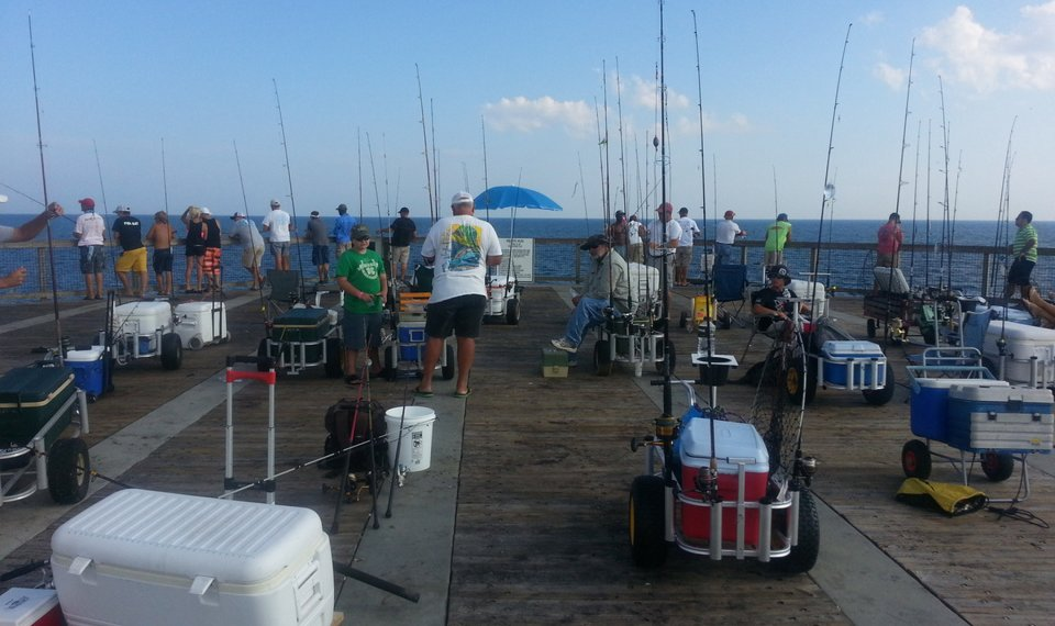 fishing carts on the pier loaded down with gear